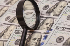 Hundred dollar banknote under magnifying glass Royalty Free Stock Photos