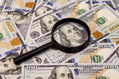 Hundred dollar banknote under magnifying glass Royalty Free Stock Image
