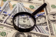 Hundred dollar banknote under magnifying glass Stock Image