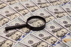 Hundred dollar banknote under magnifying glass Royalty Free Stock Photography