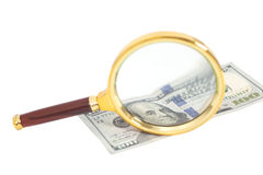 Hundred dollar banknote under magnifying glass Stock Photo