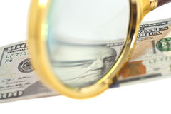 Hundred dollar banknote under magnifying glass Royalty Free Stock Images
