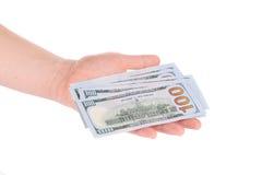 Hundred dollar banknotes on man hand. Royalty Free Stock Photos