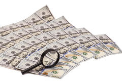 Hundred dollar banknotes under magnifying glass Stock Images