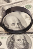 Hundred dollar banknotes under magnifying glass Royalty Free Stock Images