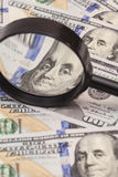 Hundred dollar banknotes under magnifying glass Royalty Free Stock Photography