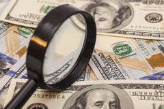 Hundred dollar banknotes under magnifying glass Royalty Free Stock Photos