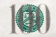 Hundred dollar bill balance scales. The scales of balance symbol on the front of a one hundred dollar bill. This is the largest bill currently printed in the Stock Photos