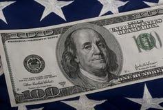 Hundred Dollar Bill. Hundred dollar (Benjamin)  bill on American flag Stock Photography