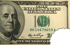 Hundred dollar bill with bite mark Stock Image