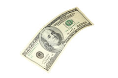 Hundred dollar bill falling on white background. Stock Photo