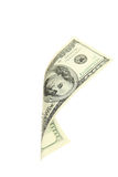 Hundred dollar bill falling on white background. Stock Photos