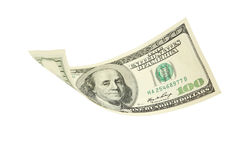Hundred dollar bill falling on white background. Royalty Free Stock Image