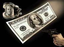 Hundred-dollar bill, handcuffs and gun rivers. concept crime Royalty Free Stock Photo