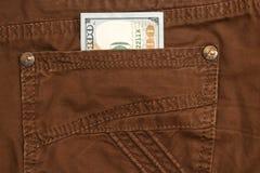 Hundred dollar bill inside back pocket jeans Stock Photography
