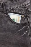 Hundred dollar bill inside front pocket jeans Royalty Free Stock Photo