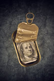 Hundred Dollar Bill in Open Empty Sardine Fish Tin Can Royalty Free Stock Image