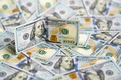 Hundred dollar bill on  pile of money. Hundred dollar bill on a pile of money Royalty Free Stock Image