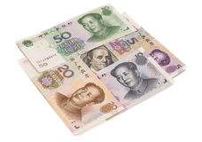 Hundred dollar bill surrounded by Chinese Yuan Royalty Free Stock Image