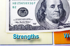 Hundred dollar bill and swot analysis close up Stock Image