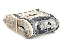 Hundred dollar bills. Folded hundred dollar bills isolated on white Royalty Free Stock Photo