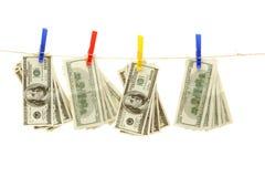Hundred dollar bills. Hanging on rope Royalty Free Stock Photo