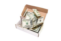 Hundred dollar bills in a big present box. isolated Stock Images