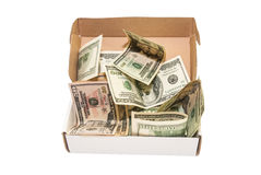 Hundred dollar bills in a big present box. isolated. Heap of hundred dollar bills in a big present box. isolated Royalty Free Stock Photos