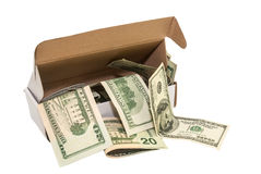 Hundred dollar bills in a big present box. isolated. Heap of hundred dollar bills in a big present box. isolated Royalty Free Stock Images