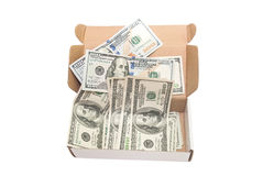 Hundred dollar bills in a big present box. isolated. Heap of hundred dollar bills in a big present box. isolated Royalty Free Stock Photo