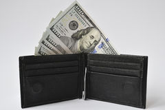 Hundred-dollar bills in black wallet. Hundred-dollar bills in black lether wallet Royalty Free Stock Photography
