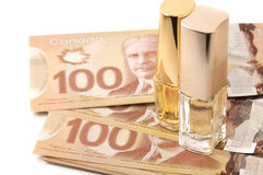 Hundred dollar bills with botlles of perfume Royalty Free Stock Photography