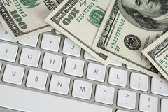 Hundred dollar bills on computer keyboard Royalty Free Stock Image