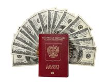 Hundred dollar bills fan with a passport Stock Image