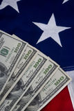 American Flag and Cash. Royalty Free Stock Photos