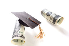Hundred dollar bills and graduation cap Royalty Free Stock Photography