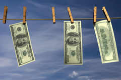 Hundred dollar bills hanging on a clothesline Royalty Free Stock Photos
