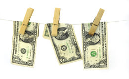 Hundred dollar bills hanging from a clothesline concept for money laundering 2016 Stock Images