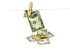 Hundred dollar bills hanging from a clothesline concept for money laundering 2016 Royalty Free Stock Photo