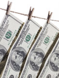 Hundred Dollar Bills Hanging From Clothesline on White Royalty Free Stock Photo