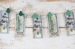 Hundred-dollar bills hanging on rope Stock Photography