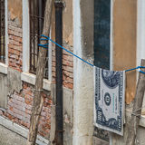 Hundred dollar bills hanging on a rope Royalty Free Stock Images