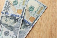 Hundred Dollar bills. On wood table Stock Image