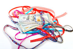 Hundred-dollar bills lying on a pile. Of gift ribbons Stock Photo
