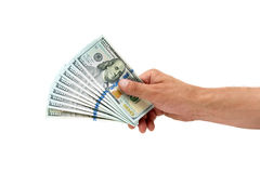Hundred-dollar bills in a man's hand on a white background Stock Photos