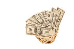 Hundred dollar bills money in the basket Royalty Free Stock Images
