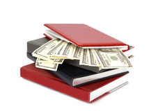 Hundred dollar bills money and notebooks Stock Image