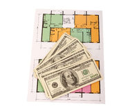 Hundred dollar bills money pile on blueprints Royalty Free Stock Photography