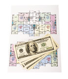 Hundred dollar bills money pile on blueprints Royalty Free Stock Image