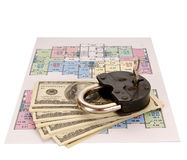 Hundred dollar bills money pile and the old castle on blueprints Royalty Free Stock Image